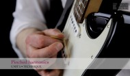 Teaching guitar students pinched harmonics